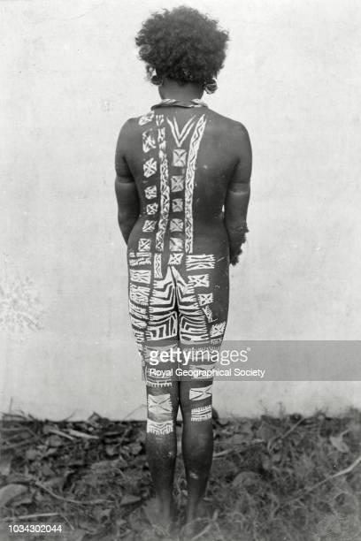 Back view of tattooed girl Papua New Guinea circa 1900