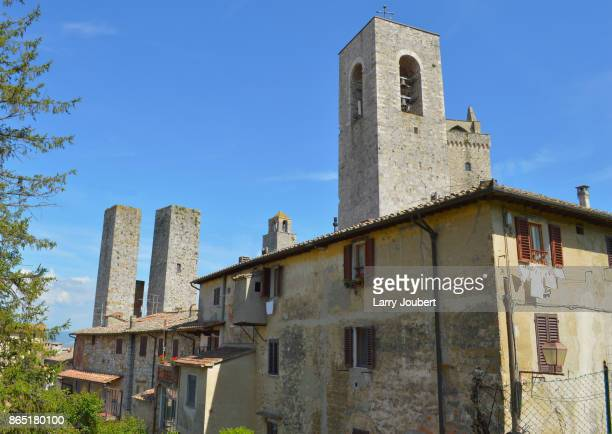 Back view of Torre Grossa in San Gimignano with other towers and buildings