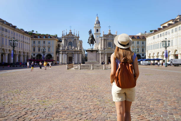 Back View Of Traveler Girl Walking In San Carlo Square Enjoying Cityscape Of Turin, Italy