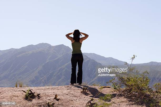 Back view of woman looking at mountains, Mendoza, Argentina