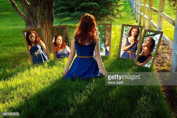 back view of woman reflected in different mirrors - tensed idaho stock photos and pictures