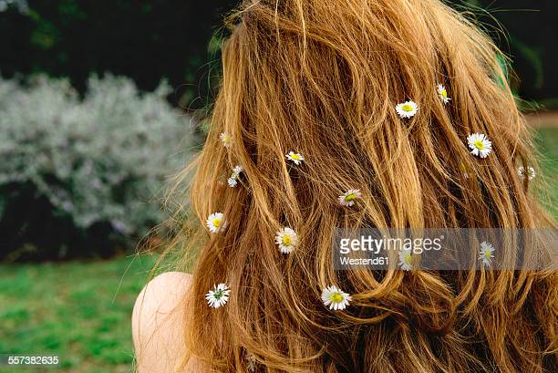 Back view of woman with daisies in her hair