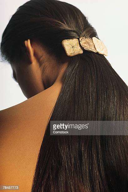 back view of woman with long hair in ponytail - 後ろで束ねた髪 ストックフォトと画像