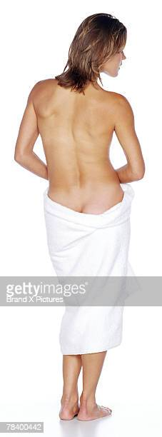 Back view of woman wrapped in towel