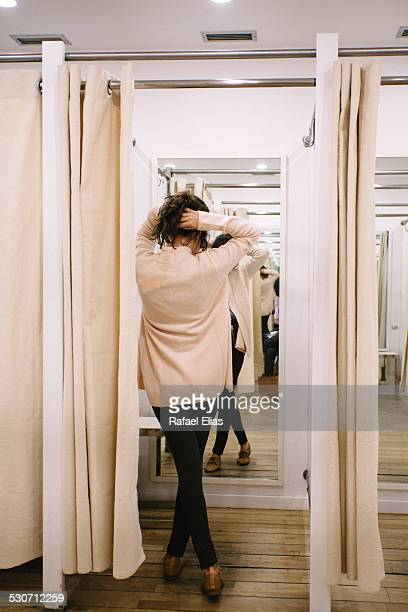Back view of young woman in changing room