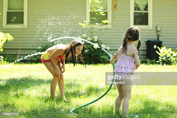 back yard play - children with water hoses - 8 girls no cup stock photos and pictures