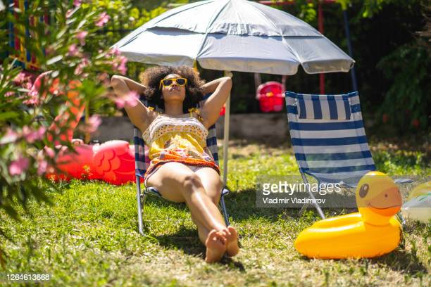 back yard staycation - sunbathing stock pictures, royalty-free photos & images