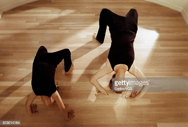 backbending with her mother - corbis images stock photos and pictures