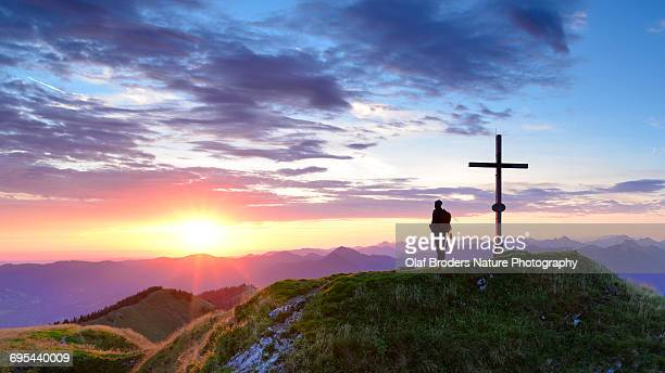 Backcountry hiker enjoys sunrise in Bavarian Alps