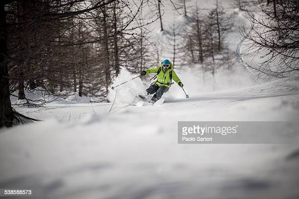 A backcountry skier descends a steep slope in Devero, Ossola, Italy.