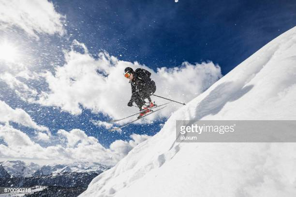 Backcountry skier jumping