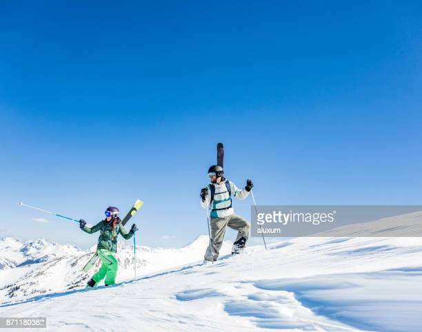 Backcountry skiers hiking up the mountain