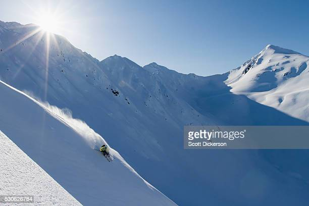 backcountry skiing in the chugach mountains in late winter; southcentral alaska, united states of america - chugach mountains stock pictures, royalty-free photos & images
