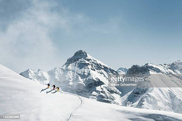 backcountry skiing - berg stock-fotos und bilder
