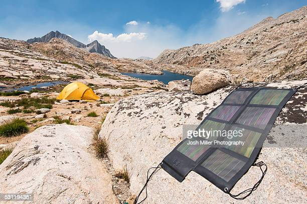 Backcountry Solar system and tent beside Big Bear Lake looking out over Seven Gables Peak, High Sierra
