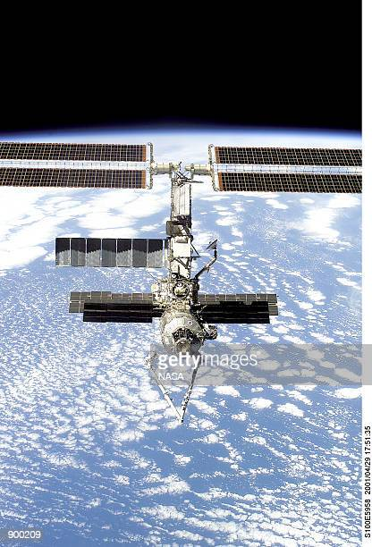 Backdropped against the Earth and sporting a readily visible new addition in the form of the Canadarm2 or space station robotic arm, the...