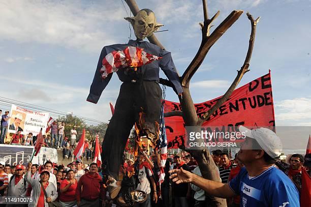 Backers of former Honduran president Manuel Zelaya rally at the international airport in Tegucigalpa on May 28 2011 awaiting for his return burn an...