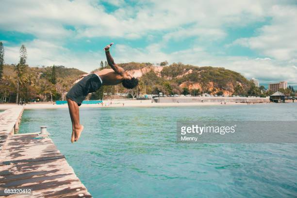 Backflip Pacific Islander jumping into the Water Noumea Beach New Caledonia