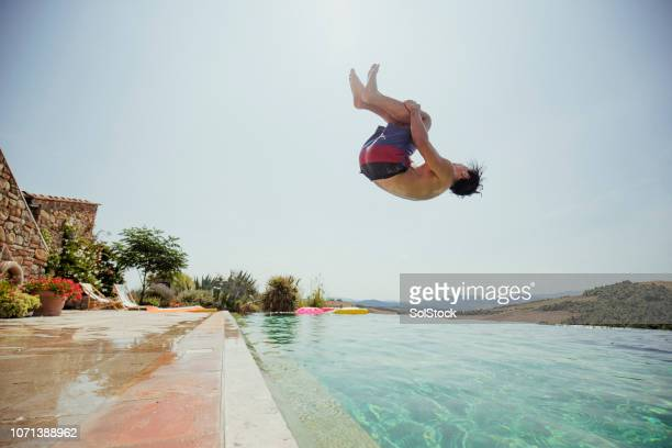 backflipping into a swimming pool - diving into water stock pictures, royalty-free photos & images