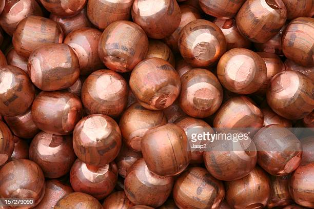 Background, a pile of little copper balls