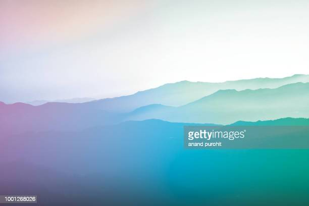 background abstract misty mountain range colourful wallpaper digital art gradiant pastel dramatic backdrop - abstrait photos et images de collection