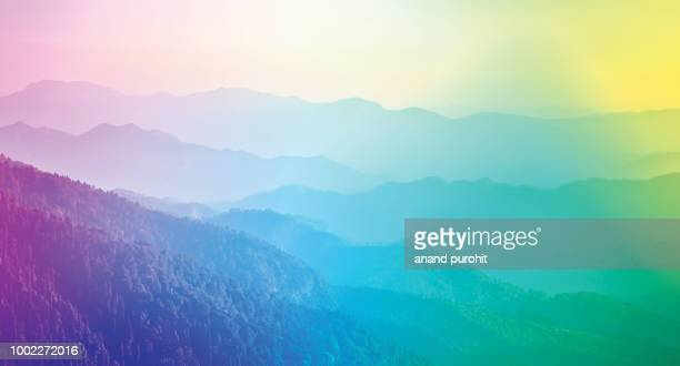 background abstract misty mountain range colourful wallpaper digital art gradiant pastel dramatic backdrop - multi colored background stock pictures, royalty-free photos & images