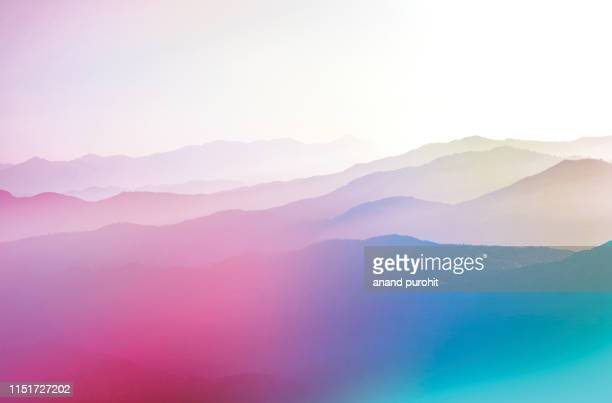 background abstract misty mountain range colourful wallpaper digital art gradiant pastel dramatic backdrop - bildhintergrund stock-fotos und bilder