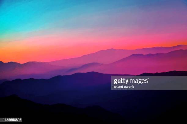 background abstract misty mountain range colourful wallpaper digital art gradiant pastel dramatic backdrop - horizontal stock-fotos und bilder