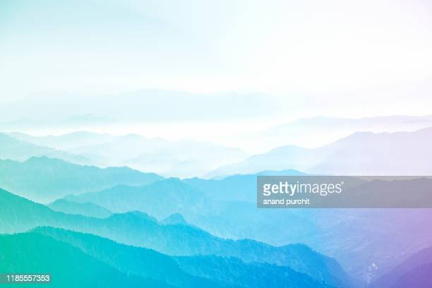 background abstract misty mountain range colourful wallpaper digital art gradiant pastel dramatic backdrop - digital composite stock pictures, royalty-free photos & images