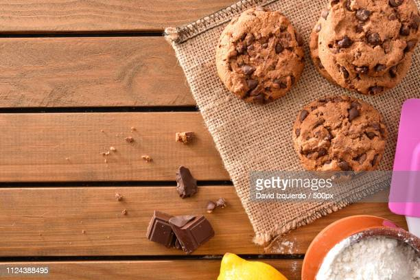 Background Biscuits With Chocolate Chips On Wooden Slatted Table