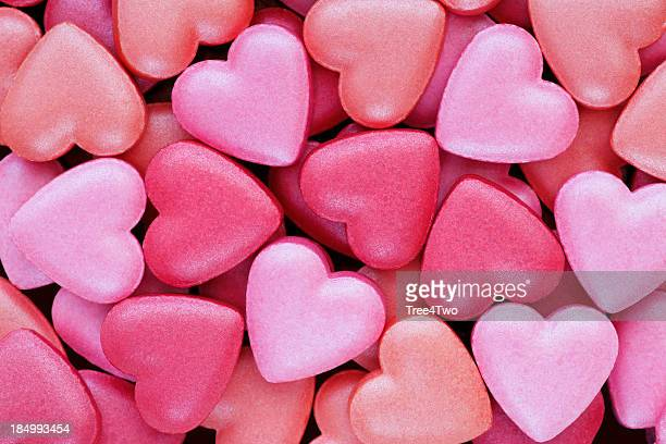 Background: Colorful, heart shaped candies suitable for Valentine greetings