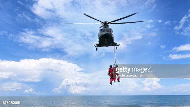 background concept for rescue helicopter in mission sea rescue . - rescue stock pictures, royalty-free photos & images