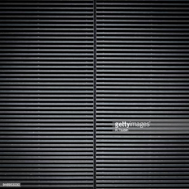 background detail of texture metal door corrugated iron panelling - corrugated iron stock photos and pictures