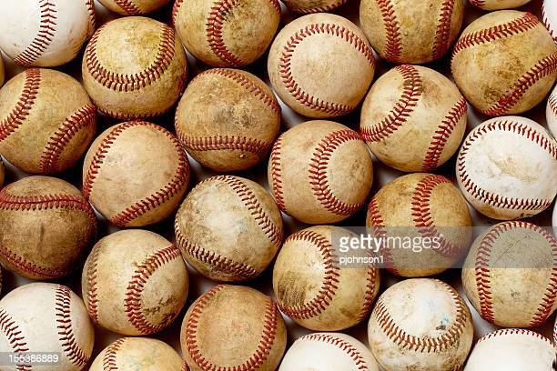 Background graphic of dirty baseballs with red lacing