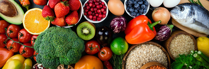 Background healthy food. Fresh fruits, vegetables, fish, berries and cereals. Healthy food, diet and healthy life concept. Top view 1089759056