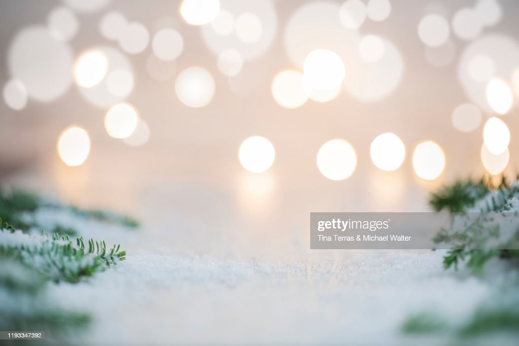 Background in Christmas mood. Bokeh and fairy lights in the background. Fir branches and snow. Copy space. : Stock Photo