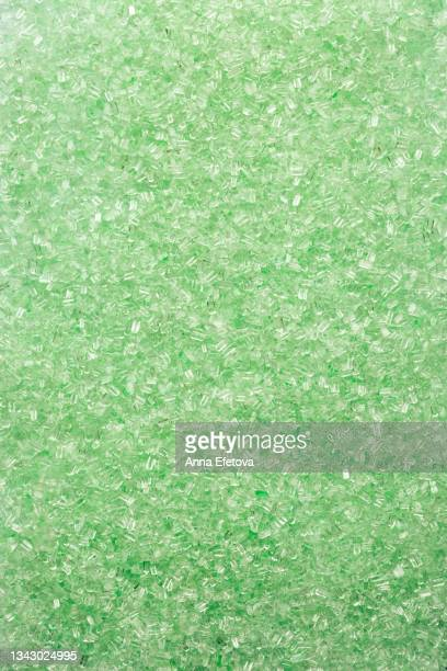 background made of green bath salt. concept of body care. flat lay style - epsom salts stock pictures, royalty-free photos & images