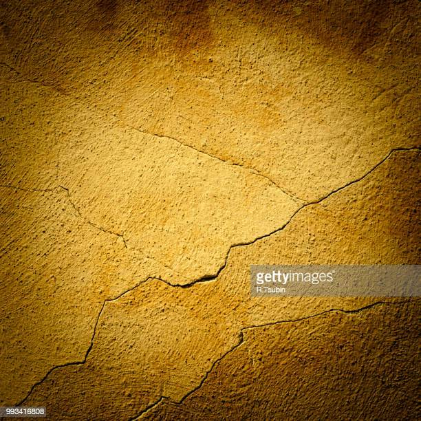 background made with a texture of a yellow wall - old parchment background burnt stock photos and pictures