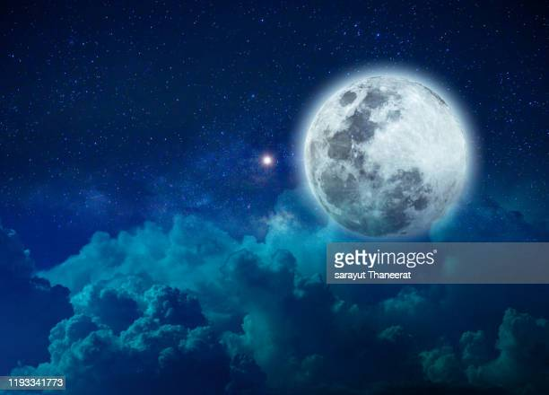 background night sky with stars moon and clouds blue sky - dreamlike stock pictures, royalty-free photos & images