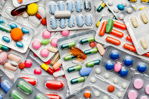 Background of a large group of assorted capsules, pills and blisters 1153740646