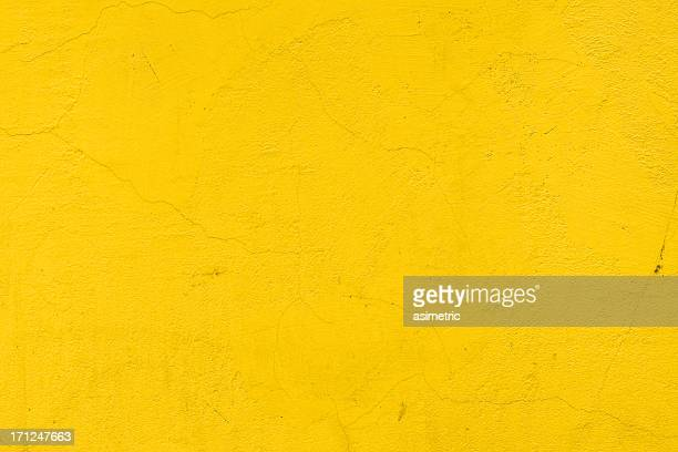 a background of a plain yellow wall - yellow stock pictures, royalty-free photos & images