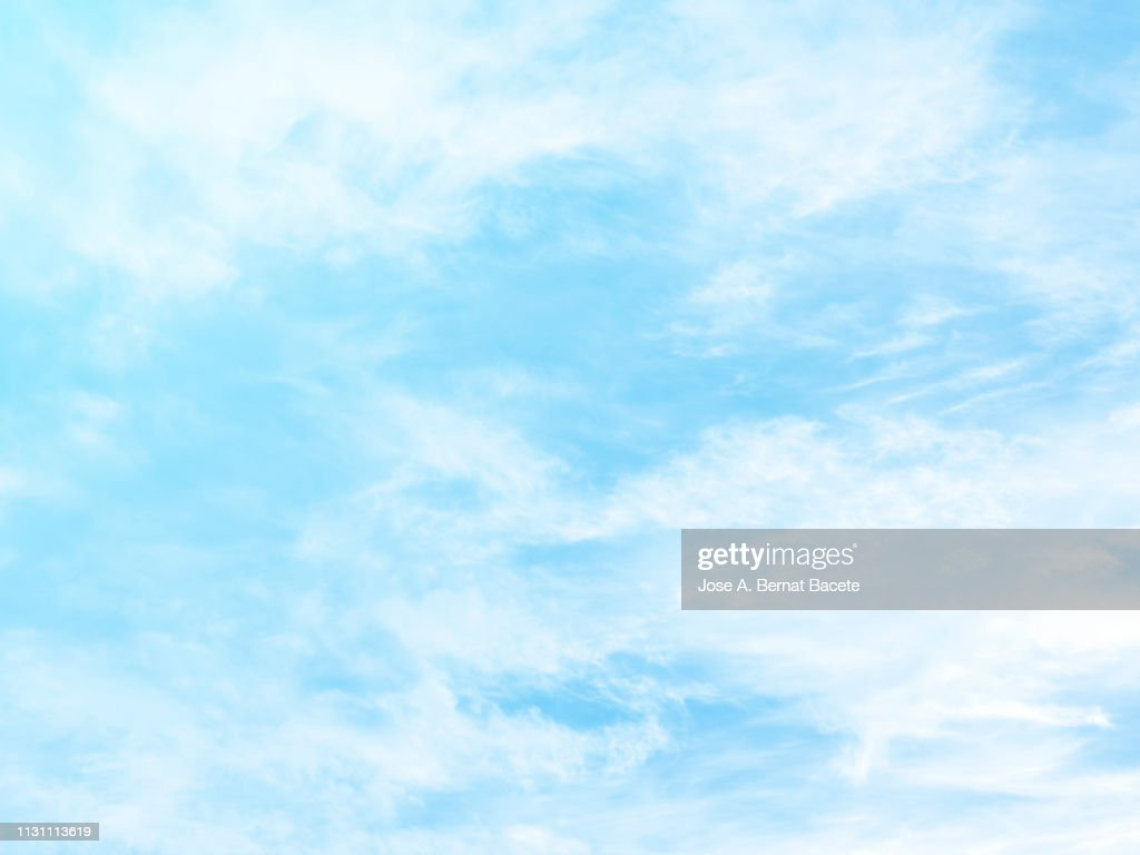 Background of a sky of light blue soft color with white clouds. : Stock Photo