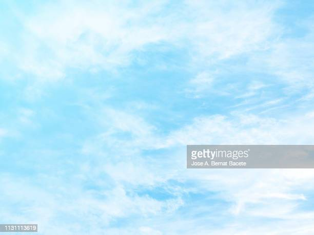 background of a sky of light blue soft color with white clouds. - cielo foto e immagini stock