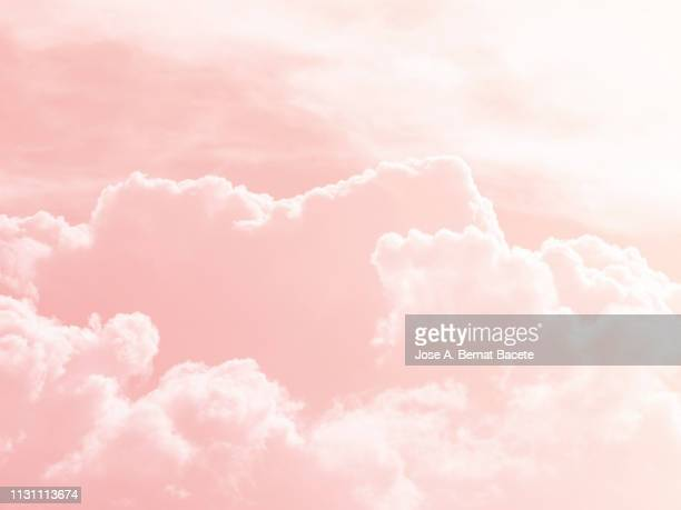 background of a sky of pink soft color with white clouds. - pink colour stock pictures, royalty-free photos & images
