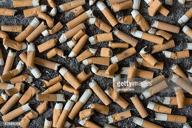 background of cigarette butts and ash - ugly wallpaper stock photos and pictures