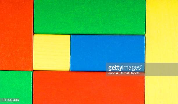 background of colored wooden blocks of rectangular  and square geometric shape. - verde color fotografías e imágenes de stock