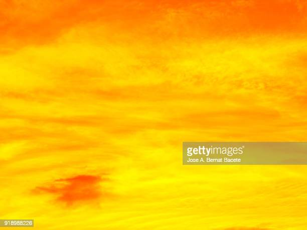 Background of forms and abstract figures of smoke and steam of colors on a orange and yellow background.