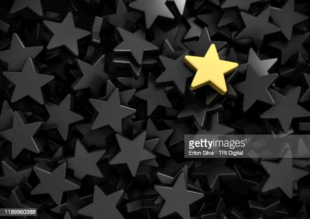 background of gray stars and one gold highlighted at the top - récompense photos et images de collection