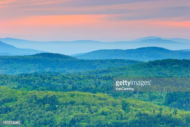 Background of green rolling mountains of Vermont at sunset