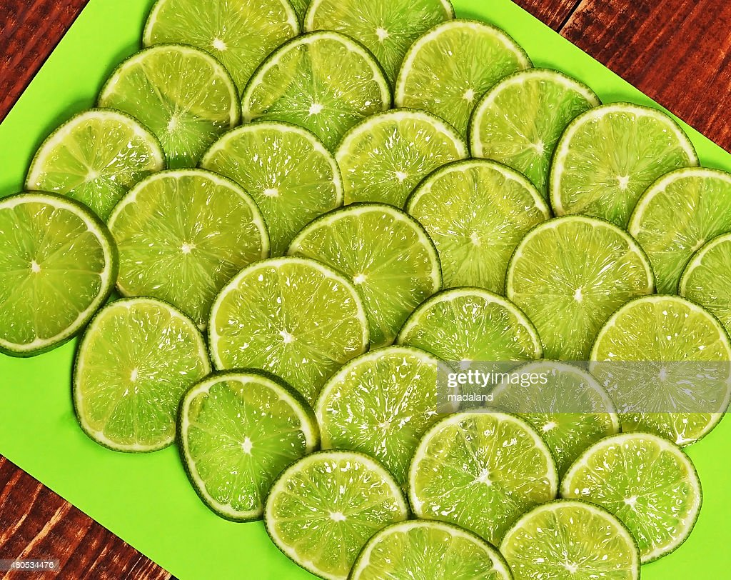 Background of heap fresh lime slices. : Stock Photo